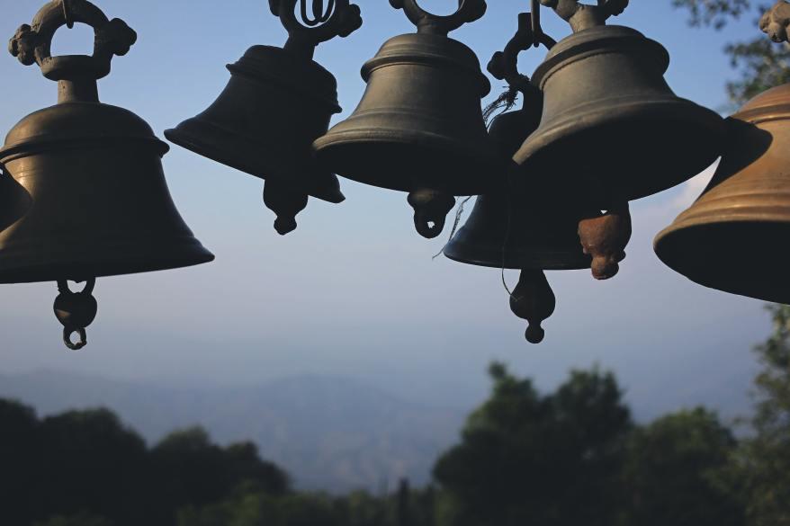 photography-of-black-hanging-bells-during-daytime-157554