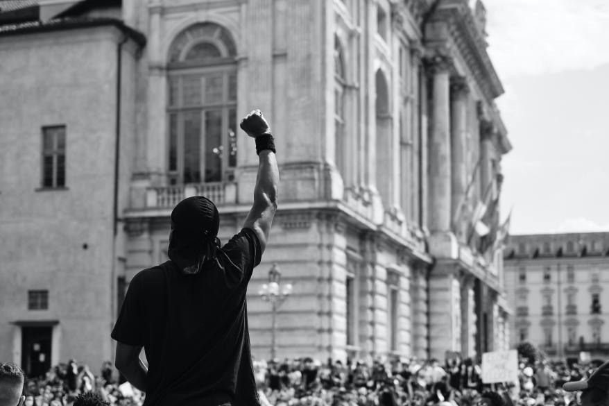 man-in-black-t-shirt-standing-infront-of-a-crowd-in-protest-4677606