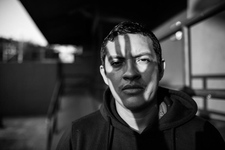 monochrome-photo-of-man-wearing-hoodie-2009872