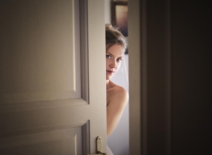 photo-of-woman-behind-door-1459558