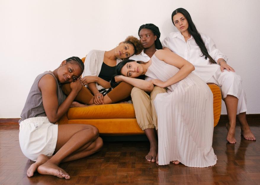 photo-of-women-sitting-on-orange-sofa-3810832
